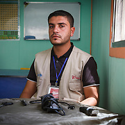 Muhammad, 25, is from Daraa, Syria where he taught kindergarten. His hobby was giving friends haircuts and shaves, with the equipment sitting in front of him. The barber equipment reminds him of the dear people he used to spend time with, while giving them cuts and shaves, which is something he hasn't done since the last person he gave a hair cut, his best friend, was killed in the conflict. <br /> <br /> Since moving to the camp Muhammad has gotten married and had a baby. <br /> Muhammad is in a Mercy Corps resource room where he teaches students with disabilities. Zaatari camp for Syrian refugees, Jordan, May 2015.