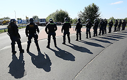 © London News Pictures. Hungarian police prepare to contain migrants close to the Hungarian and Serbian border town of Roszke, Hungary, September 8 2015. The UN's humanitarian agencies are on the verge of bankruptcy and unable to meet the basic needs of millions of people because of the size of the refugee crisis in the Middle East, Africa and Europe, senior figures within the UN have told the media.   Picture by Paul Hackett /LNP