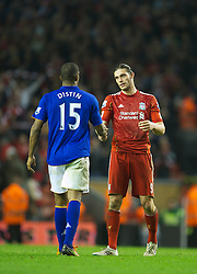 LIVERPOOL, ENGLAND - Tuesday, March 13, 2012: Liverpool's Andy Carroll shakes hands with Everton's Sylvain Distin during the Premiership match at Anfield. (Pic by David Rawcliffe/Propaganda)