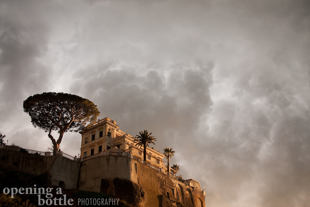 A thunderstorm moves in on a clifftop villa above the harbor of Sorrento, Campania, Italy.