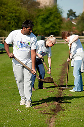 NatWest staff members Pav Kamal Nicola Stanley and Helen Williamson Heidi Hughes rake out dead grass and reseed areas of the pitch at Drax Cricket club near Selby on Sunday Morning (10April 2011)..10 April 2011.Images © Paul David Drabble