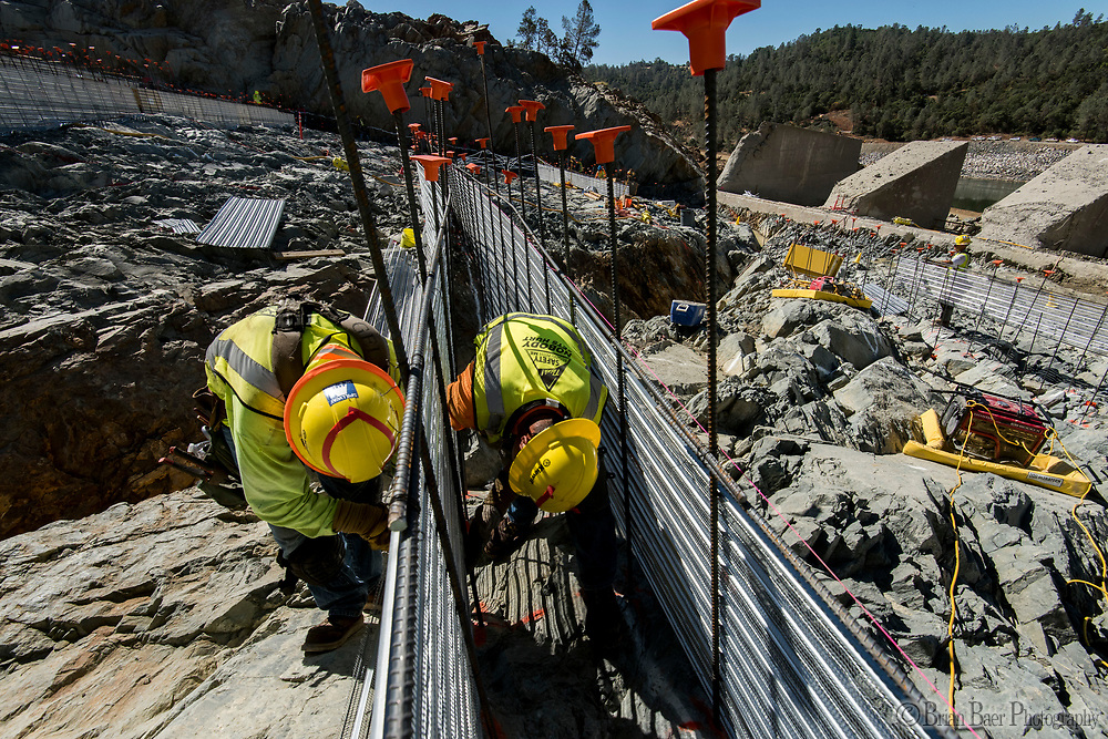 Workers install stay-in-place concrete forms before concrete is poured between them on the lower chute of the Lake Oroville flood control spillway in Butte County, California. Photo taken July 12, 2017. <br /> Brian Baer/ California Department of Water Resources<br /> FOR EDITORIAL USE ONLY