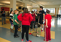 "Nike Ambassador James McDonald goes over the rules for ""capture the football"" during Laconia Middle School's after school program on Thursday.  (Karen Bobotas/for the Laconia Daily Sun)"