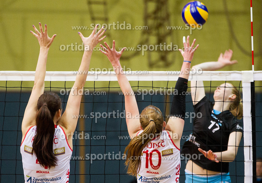 Marina Kaucic of Nova KBM Branik and Sara Najdic of Nova KBM Branik vs Lana Scuka of OK Calcit Volleyball  during volleyball match between OK Calcit Kamnik and Nova KBM Branik Maribor in 6th Round of Women MEVZA league 2014/15, on December 13, 2014 in Sports Arena Kamnik, Kamnik, Slovenia. Photo by Vid Ponikvar / Sportida
