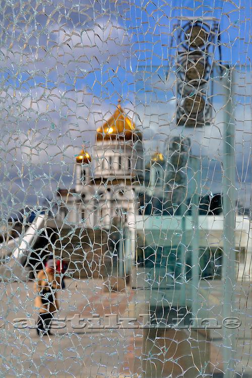 View on church through broken glass.