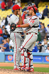 May 31, 2018 - Los Angeles, CA, U.S. - LOS ANGELES, CA - MAY 28: Philadelphia Phillies pitcher Seranthony Dom'nguez (58) celebrates with Philadelphia Phillies catcher Jorge Alfaro (38) after a MLB game between the Philadelphia Phillies and the Los Angeles Dodgers on Memorial Day, May 28, 2018 at Dodger Stadium in Los Angeles, CA. (Photo by Brian Rothmuller/Icon Sportswire) (Credit Image: © Brian Rothmuller/Icon SMI via ZUMA Press)