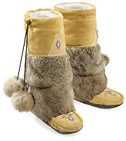 yellow leather boots with furry ankles and decorative fur balls