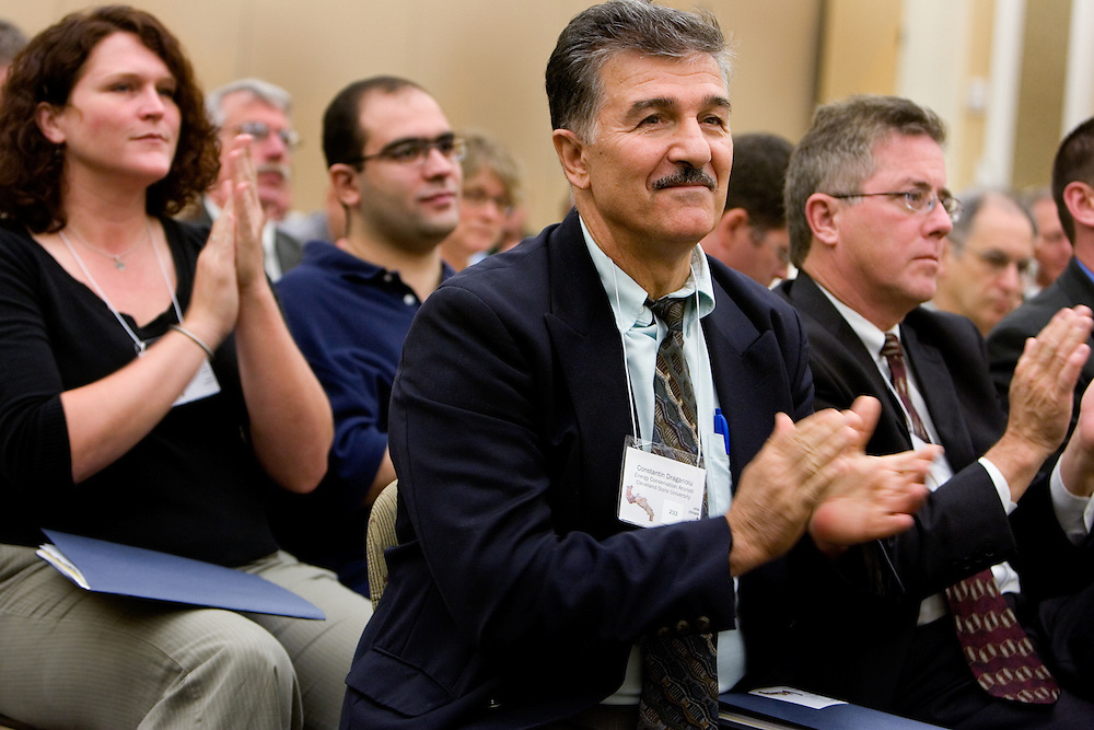 Constantine Draganoiu, Energy Conservation Analyst for Cleveland State University, applauds with the audience at the close of the morning session during the Ohio Climate & Energy Workshop at O.U.'s Baker Center on Thursday, 10/4/07.