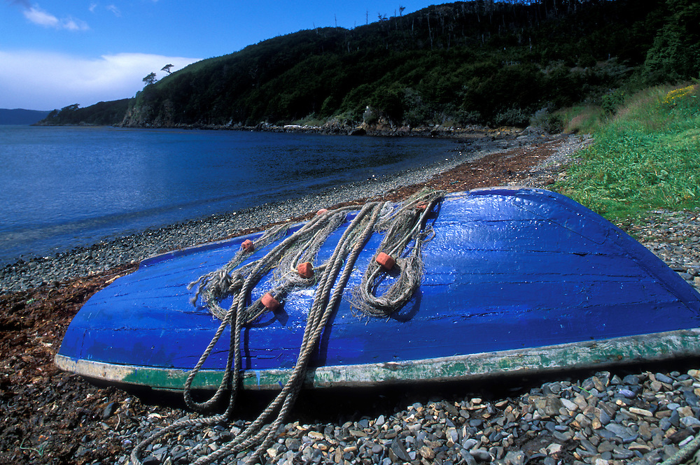 Chile, Isla Navarino, Fisherman's skiff hauled out on beach in small fishing village of Puerto Torro, near Cape Horn