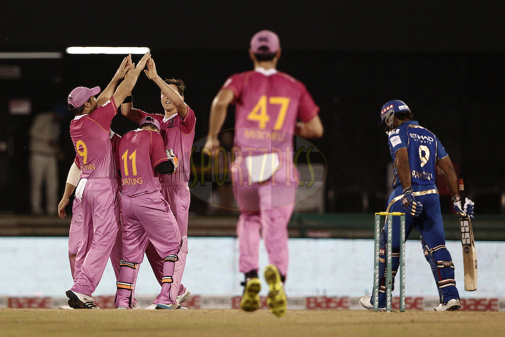 Scott Kuggeleijn of the NORTHERN KNIGHTS celebrates the wicket of Ambati Rayudu of the Mumbai Indians  during the qualifier 6 match of the Oppo Champions League Twenty20 between the Mumbai Indians and the Northern Knights held at the Chhattisgarh International Cricket Stadium, Raipur, India on the 16th September 2014<br /> <br /> Photo by:  Deepak Malik / Sportzpics/ CLT20<br /> <br /> <br /> Image use is subject to the terms and conditions as laid out by the BCCI/ CLT20.  The terms and conditions can be downloaded here:<br /> <br /> http://sportzpics.photoshelter.com/gallery/CLT20-Image-Terms-and-Conditions-2014/G0000IfNJn535VPU/C0000QhhKadWcjYs