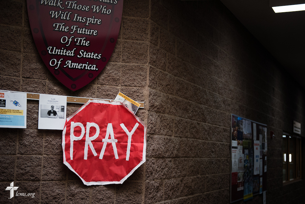 A sign reminds passing students to pray at Faith Lutheran Middle School & High School on Tuesday, May 26, 2015, in Las Vegas, Nev.  LCMS Communications/Erik M. Lunsford