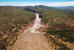 The Fitzroy River leads into Dimond Gorge in the distance on Old Mornington Station.  In 1996 a campaign by Traditional owners and local environmentalists put a stop to a plan to dam the Fitzroy River at  Dimond Gorge.