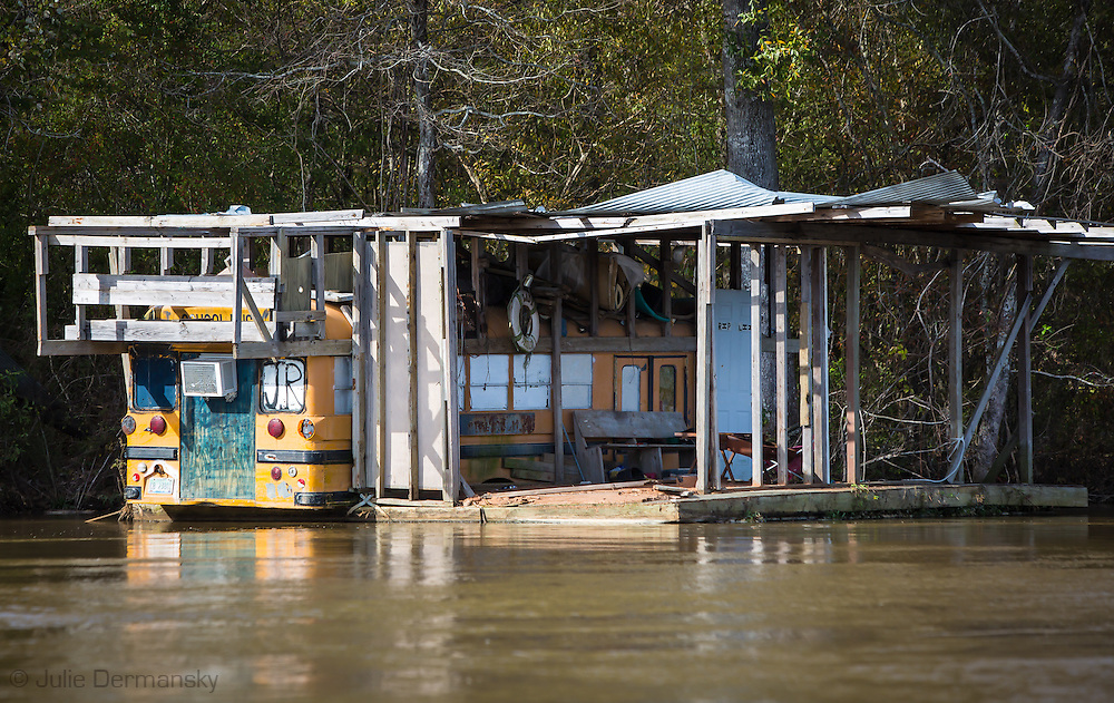 School bus turned into a fishing camp on the the Pearl River in St. Tammany Parish, Louisiana, lined with Cypress and Tupelo trees.