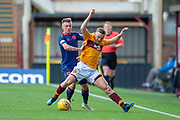 Callumn Morrison(#38) of Heart of Midlothian challenges Allan Campbell (#8) of Motherwell FC during the Ladbrokes Scottish Premiership match between Motherwell and Heart of Midlothian at Fir Park, Motherwell, Scotland on 15 September 2018.