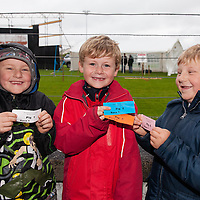 Tristan and Daniel McCarthy and Peader Kelly with their betting slips at the Kilmihil Festival of Fun Pig Racing 2015
