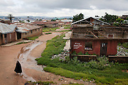 A lone Muslim woman is walking by a series of destroyed homes in Dutse Uku, pop. 40.000, a Muslim-dominated neighbourhood in Jos, Plateau State, Nigeria. Residents of Dutse Uku clashed and were attacked by a neighbouring Christian community after local government elections in 2008. 380 houses were destroyed, and around 20 people were killed. All Christians have since then left their homes within the community, in order to resettle in Christian-dominated areas of the city.