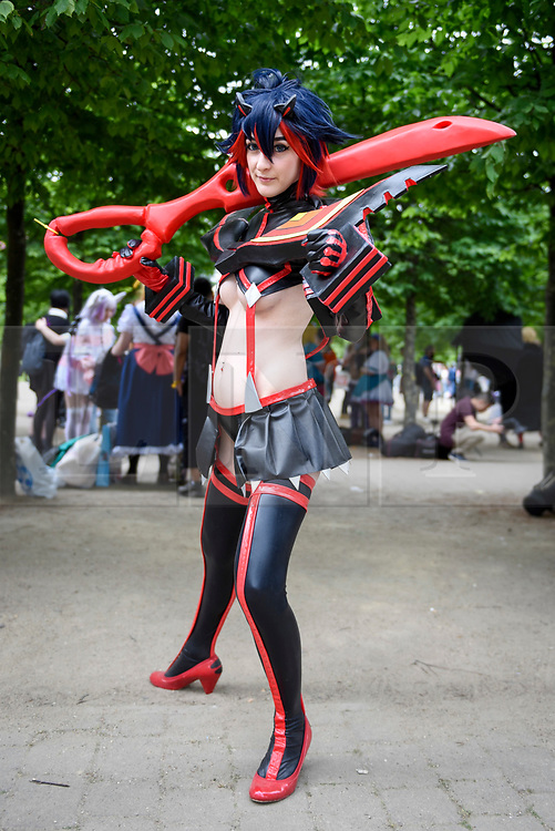 © Licensed to London News Pictures. 28/05/2017. London, UK.  A girl dressed as Ryuko from Kill La Kill anime at MCM Comic Con taking place at Excel in East London.  The three day event celebrates popular comic books, anime, games, television and movies.  Many attendees take the opportunity to dress as their favourite characters.    Photo credit : Stephen Chung/LNP