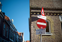 These street signs stand on the corner near the 'Red Light District'.<br /> <br /> After living abroad for more than three years I visited my old home town. Wondering what has changed I packed both my curiosity and a camera. (Original posted as part of a photo essay 'Revisiting Familiar Grounds' here: http://www.basslabbers.com/WP/?p=1320)