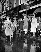 'Bus Fares Up' Maureen Potter finds an alternative mode of travel as a protest about an imminent increase in bus fares on Grafton Street..15.01.1960