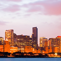 Chicago skyline panorama photo at dusk. Panorama photo ratio is 1:3 and includes Willis Tower (Sears Tower), CNA building, Trump Tower, Prudential buildings, and other office buidlings along the Chicago lakefront.