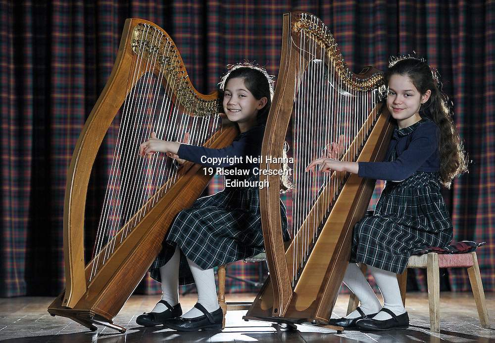 JP License<br /> <br /> Edinburgh International Harp Festival 1-6th April 2016.<br /> <br />  Clara and Brigitte Harrigan Lees.<br /> Age 9.<br /> Started learning harp at age 6.<br /> Study harp with Helen MacLeod at St Mary&rsquo;s Music School, where they are choristers.<br /> This is their 3rd year at the EIHF.<br /> They are participating in one of the harp courses and will attend various concerts at the festival.<br /> <br />  Neil Hanna Photography<br /> www.neilhannaphotography.co.uk<br /> 07702 246823