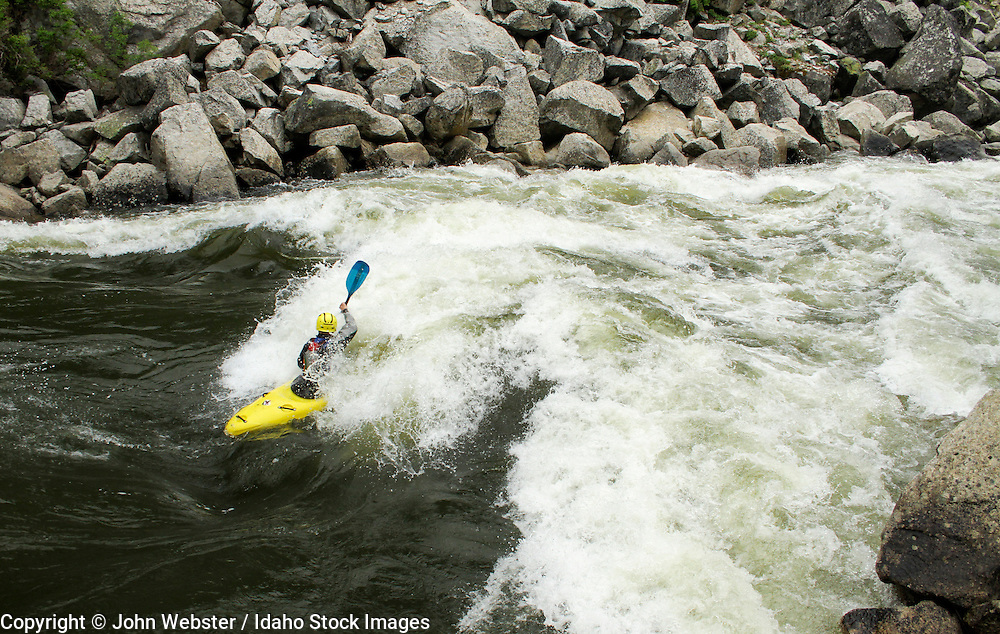 Micah Kneidl paddling into the rapid Disneyland. North Fork of the Payette, Idaho.