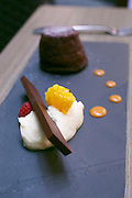 "Singapore. Level 33 Restaurant & Lounge offers ""experimental penthouse dining in the World's highest urban craft-brewery.""<br /> Cocoa: Warm chocolate fondant, ganache, orange mascarpone and mandarin shrapnel."