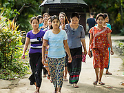 08 NOVEMBER 2015 - YANGON, MYANMAR: Women walk towards a polling place in North Okkalapa, a township outside of central Yangon. The citizens of Myanmar went to the polls Sunday to vote in the most democratic elections since 1990. The National League for Democracy, (NLD) the party of Aung San Suu Kyi is widely expected to get the most votes in the election, but it is not certain if they will get enough votes to secure an outright victory. The polls opened at 6AM. In Yangon, some voters started lining up at 4AM and lines were reported to long in many polling stations in Myanmar's largest city.      PHOTO BY JACK KURTZ