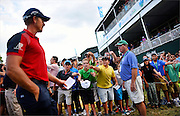 Henrik Stenson greets a group of young fans during the third round The Barclays Championship held at Plainfield Country Club in Edison, New Jersey on August 29.