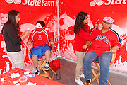ANAHEIM, CA - APRIL 22:  Los Angeles Angels of Anaheim fans get their faces painted at FanFest before the game against the Baltimore Orioles on Sunday, April 22, 2012 at Angel Stadium in Anaheim, California. The Orioles won the game 3-2 in ten innings. (Photo by Paul Spinelli/MLB Photos via Getty Images)