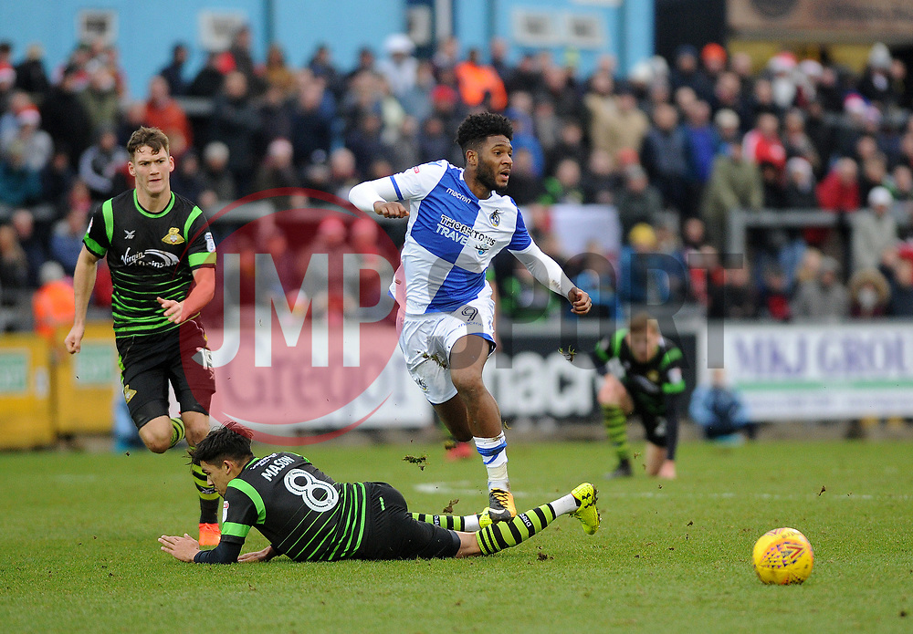 Ellis Harrison of Bristol Rovers skips over a challenge from Niall Mason of Doncaster Rovers - Mandatory by-line: Neil Brookman/JMP - 23/12/2017 - FOOTBALL - Memorial Stadium - Bristol, England - Bristol Rovers v Doncaster Rovers - Sky Bet League One
