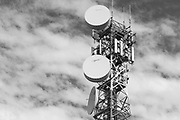 cellular and microwave antennas on a red and white communications tower in Narrabri, New South Wales, Australia