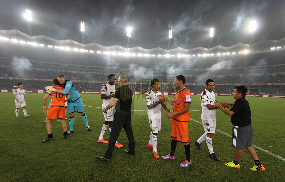NorthEast United FC coach Ricki Herbert  shake hand with Delhi Dynamos FC and NorthEast United FC after match 16 of the Hero Indian Super League between The Delhi Dynamos FC and NorthEast United FC held at the Jawaharlal Nehru Stadium, Delhi, India on the 29th October 2014.<br /> <br /> Photo by:  Arjun Panwar/ ISL/ SPORTZPICS