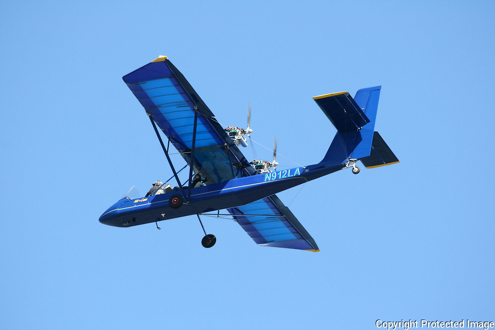 Large blue ultra light plane giving air tours of Jekyll Island