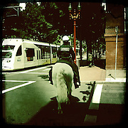 Photos taken with the hipstamatic app on the iPhone.  Mounted Police on horseback in Portland, Oregon.  Light rail Max train new.