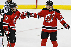 Mar 20, 2009; Newark, NJ, USA; New Jersey Devils left wing Zach Parise (9) congratulates New Jersey Devils left wing Patrik Elias (26) on his goal during the third period at the Prudential Center.  The Devils defeated the Wild 4-0.