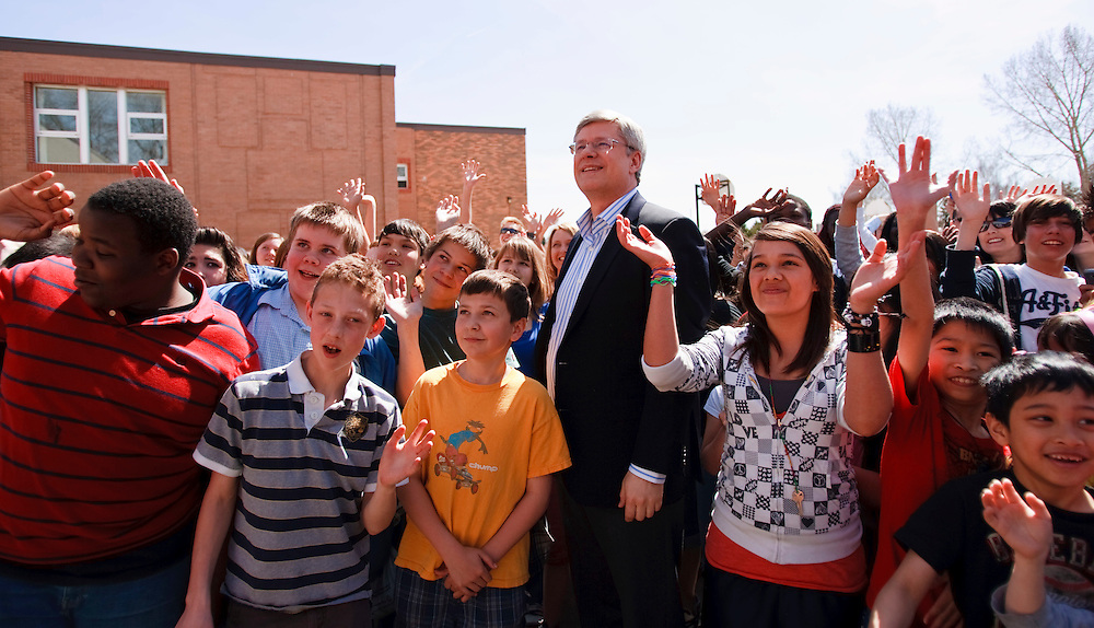 Conservative leader Prime Minister Stephen Harper poses for a picture with students at St. Augustine Catholic school in Calgary, Alberta where he was voting in Canada's 41st federal election May 2, 2011.<br /> AFP/GEOFF ROBINS/STR