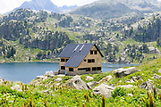 Refuge house at Colomers Lakes in the catalan Pyrenees, Spain. Part of the Parc Nacional d'Aigüestortes i Estany de Sant Maurici