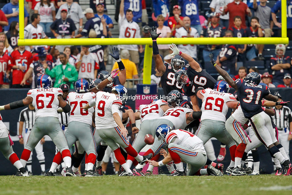October 10, 2010; Houston, TX USA; New York Giants place kicker Lawrence Tynes (9) kicks against the Houston Texans during the second half at Reliant Stadium. The Giants defeated the Texans 34-10. Mandatory Credit: Derick E. Hingle