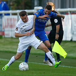 Dovers defender Jack Connors and Eastleighs midfielder Mark Yeates both go for the ball during the National League match between Dover Athletic FC and Eastleigh FC at Crabble Stadium, Kent on 25 August 2018. Photo by Matt Bristow.