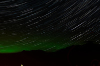 Night Sky, Star Trails, and Northern Lights looking northeast from Haines, Alaska. Composite of images from 03:00 to 03:29 taken with a Nikon D3x camera and 45 mm f/2.8 PC-E lens (ISO 400, 45 mm, f/5.6, 29 sec). Raw images processed with Capture One Pro and the composite generated using Photoshop CC (statistics, maximum).