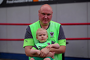 Wimbledon fans Stuart Deacons and son Thomas during the Pre-Season Friendly match between Hampton & Richmond and AFC Wimbledon at Beveree Stadium, Richmond Upon Thames, United Kingdom on 27 July 2019.