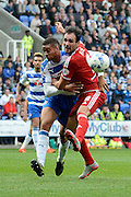 Reading defender Michael Hector and Middlesbrough striker Kike tussle for the ball during the Sky Bet Championship match between Reading and Middlesbrough at the Madejski Stadium, Reading, England on 3 October 2015. Photo by Alan Franklin.