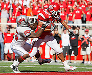 UNLV safety Mike Grant (25) is unable to stop Utah runningback Eddie Wide (36) as he scores a touchdown in the 4th quarter of an NCAA college football game at Rice-Eccles Stadium, Saturday, Sept. 11, 2010, in Salt Lake City, Utah.  Utah defeated UNLV 38-10.(AP Photo/Colin E. Braley)