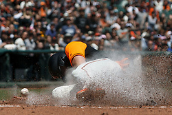 SAN FRANCISCO, CA - AUGUST 26: Evan Longoria #10 of the San Francisco Giants slides into home plate to score a run on a passed ball during the first inning against the Texas Rangers at AT&T Park on August 26, 2018 in San Francisco, California. The San Francisco Giants defeated the Texas Rangers 3-1. All players across MLB will wear nicknames on their backs as well as colorful, non-traditional uniforms featuring alternate designs inspired by youth-league uniforms during Players Weekend. (Photo by Jason O. Watson/Getty Images) *** Local Caption *** Evan Longoria