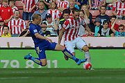 Stoke City's Marko Arnautovic rides a challenge during the Barclays Premier League match between Stoke City and Leicester City at the Britannia Stadium, Stoke-on-Trent, England on 19 September 2015. Photo by Aaron Lupton.