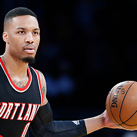 26 March 2016: Portland Trail Blazers guard Damian Lillard (0) passes the ball during the Portland Trail Blazers 97-81 victory over the Los Angeles Lakers, at the Staples Center, Los Angeles, California, USA.