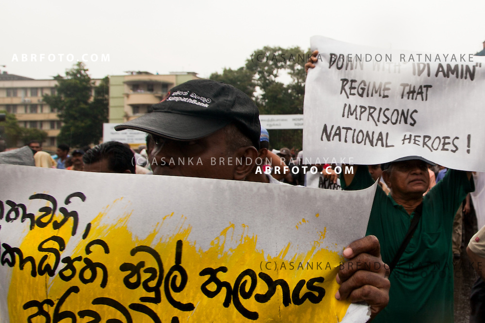 Protestors holding banner opposing the arrest of Sarath Fonseka during a protest in lieu of the arrest of Former Army General Sarath Fonseka in Colombo Sri Lanka. By Asanka Brendon Ratnayake