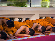 31 DECEMBER 2014 - BANGKOK, THAILAND: Buddhist monks pray on New Year's Eve at Wat Pathum Wanaram in Bangkok. Hundreds of thousands of people pack into the Ratchaprasong Intersection in Bangkok for the city's annual New Year's Eve countdown. Many Thais go the Erawan Shrine and Wat Pathum Wanaram near the intersection to pray and make merit before going to their New Year's parties.    PHOTO BY JACK KURTZ