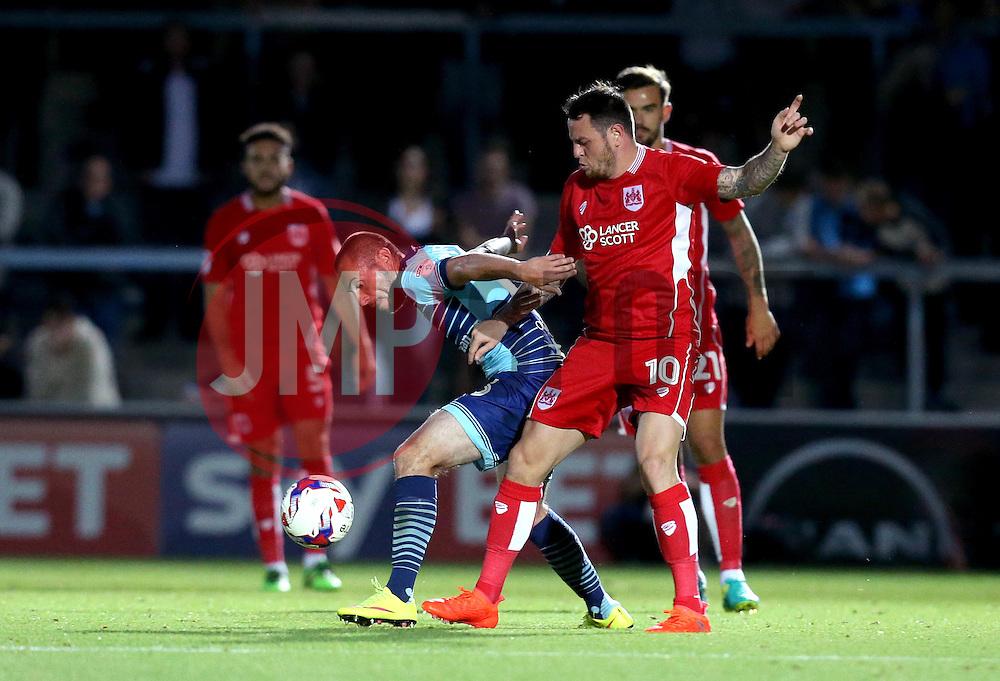 Michael Harriman of Wycombe Wanderers goes past Lee Tomlin of Bristol City - Mandatory by-line: Robbie Stephenson/JMP - 09/08/2016 - FOOTBALL - Adams Park - High Wycombe, England - Wycombe Wanderers v Bristol City - EFL League Cup